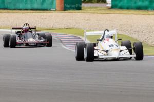 BRNO, Czech Republic - 04. Juli 2014: ADAC HAIGO Historic Formel Cup, Rennen 1, Nils-Holger Wilms, M 90 führt in der 2. Runde vor Falk Schwarze, MTX 1-06